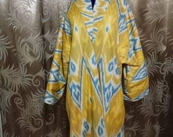 Uzbek traditional handwoven cotton ikat long chapan. Adras kaftan, tribal ethnic coat. Uzbek ikat robe
