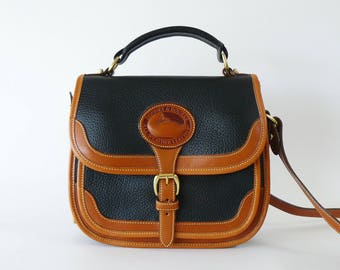 Dooney & Bourke Black and British Tan Crossbody Carrier Bag AWL