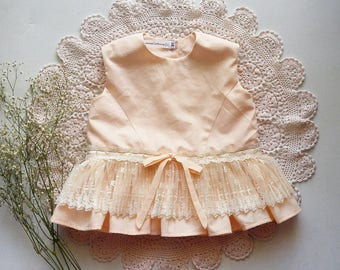 Peach Peplum Shirt by Papoose Clothing