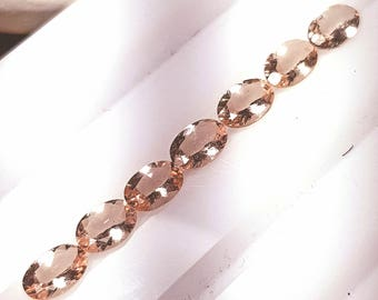 1 7 by 5mm Morganite oval cut pink peach 0.65ct average weight
