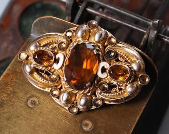 Vintage filigree brooch, with glass rhinestones, lost stones