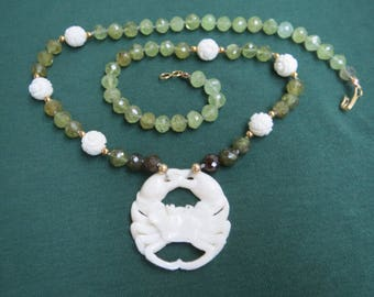 Carved Crab Pendant on Hand Knotted Green Garnet and Carved Bone Necklace