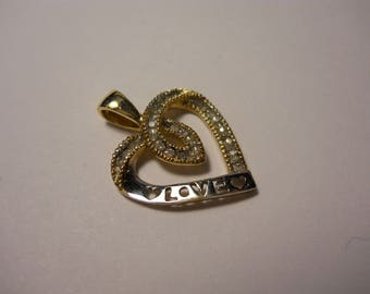 A Must See 10 KT Solid Yellow Gold Diamond Love Pendant