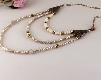 Bohemian wedding choker with glass pearls in ivory champagne. Handmade bridal necklace with tiny lilac beads and copper. Vintage style.