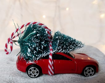 Red Family Car with Tree Strapped to the Top Ornament by Distinguished Flamingo