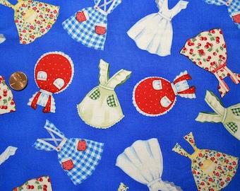 Vintage Aprons on Blue Fabric