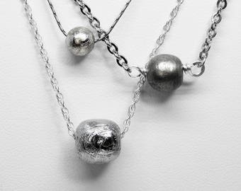 Gibeon Meteorite Necklaces in Silver and Stainless Steel
