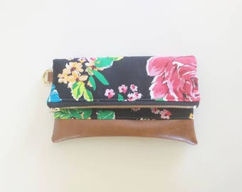 Black and bright floral print and brown faux leather clutch