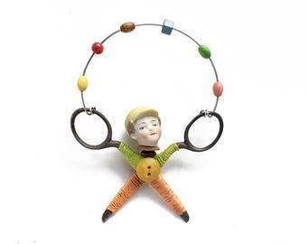 little JUGGLER (9), original art doll ornament, found object art, mixed media assemblage, by Elizabeth Rosen