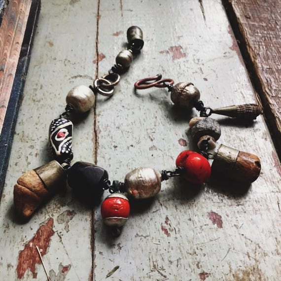 Tribal amulet bracelet with bone, stone, red coral and Ethiopian beads