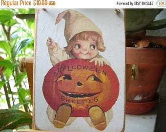 3 day SUMMER SALE 15% OFF Halloween Greetings, pumpkin, Jack o lantern,googly eyed child image on wooden tag with string to hang