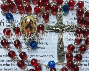 Ruby Czech glass and Capri blue Swarovski crystal rounde bead rosary with silver plated Our Lady Untier of Knots center and crucifix