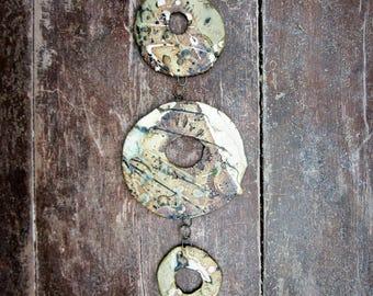 Abstract mobile, wall hanging, garden art. 5 irregular rings/discs. Ceramic stoneware. Ammonites
