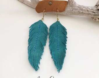 Genuine leather feather earrings // turquoise teal blue leather // boho jewelry // western jewelry earrings // gypsy // rodeo // cowgirl //