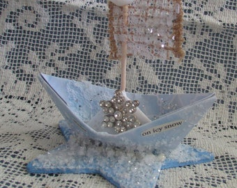 whimsical paper boat snow winter is coming star xmas dream winter on icy snow frozen cake topper centerpiece