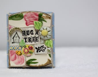 HUG A TREE,  mosaic, pique assiette, mosaic art, birdhouse, bugs
