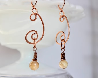 Hammered copper, mother of pearl, and copper bead earrings on lever back closure