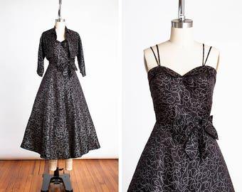 DROP DEAD GORGEOUS 1950s Charcoal Silk Cocktail Dress with Silver Metallic Swirls, Petal Bust and Matching Bolero // Atomic // Full Skirt //