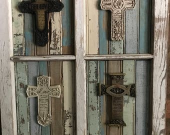 Four paned window with rustic wood and crosses