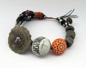 Before The Night Closed In - rustic mixed media bracelet; orange and navy, grungy post-apocalyptic tribal primitive assemblage bracelet