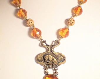 Czech faceted Amber Glass Bead Necklace With Lion and Snakes Watch Fob Pendant