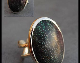 Iridescent green ring purple clay