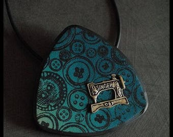 Pendant in gradient polymer clay with light blue with Teal patterned buttons