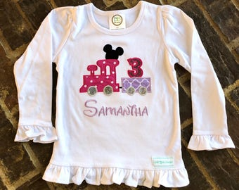 Girl's ruffled Mickey Mouse appliquéd train shirt with embroidered name and birthday number