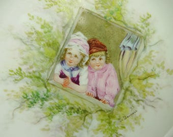 French Porcelain Bowl, Hand Painted and Signed J Douniere 1895, Two Children Through Ivy Surrounded Window 9 Inches In Diameter, 2 Ins Deep