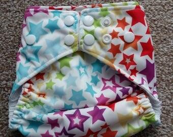 Rainbow star's petite os pocket nappy.