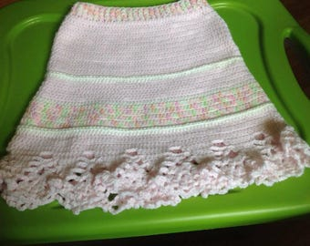 Skirt, crocheted. Pink and pastels, waist 18 inches, belly 22 inches, hips 25 inches, length 12.5 inches, girl