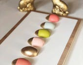 Gold tipped egg sign
