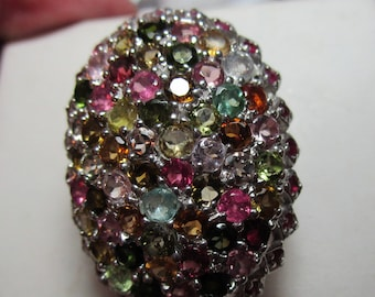 Ladies huge mined tourmaline ring with rubies in sterling