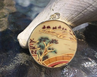 Japanese style landscape porcelain pendant. Hand made and hand painted. Different in details of each one  Very pretty!