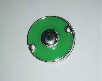 X 1 large green/silver connector