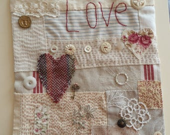 Textile artwork - 'Two hearts, one key'. A hand-stitched piece of collage art