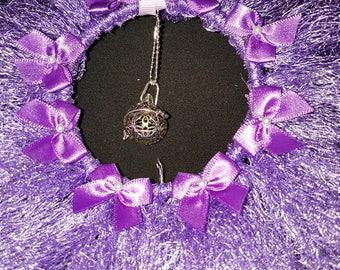 Purple bow wreath with aromatherapy pendant