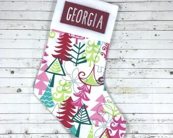 Personalised christmas stocking with embroidered name, multi coloured christmas tree design, designer fabric