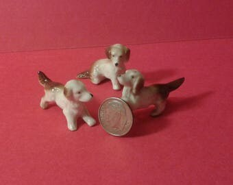 Three ceramic dogs