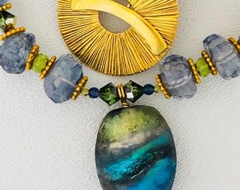 Blue Topaz necklace with hanblown glass pendant