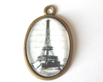 1 oval bronze pendant, cabochon Eiffel Tower black and white