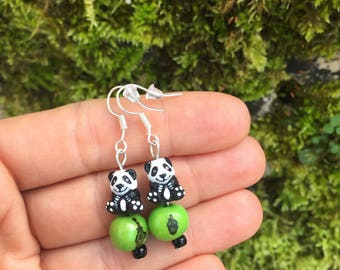 Cute ethnic earrings with peruvian ceramic panda beads and exotic seeds