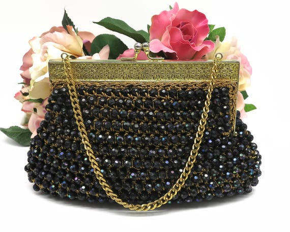 Vintage black beaded handbag with large iridescent beads crocheted into gold metallic thread, gold filigree frame, rhinestone kiss lock