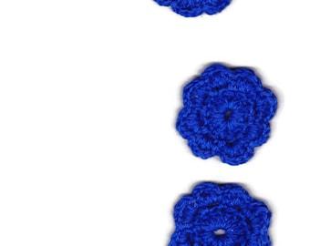 3 crocheted blue flowers