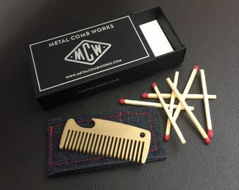 Compact metal pocket combs. Crafted to last a lifetime from brass or titanium. Excellent general purpose hair or beard comb. Made in USA.