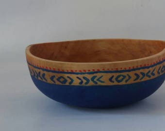 Birch bowl with painted pattern.