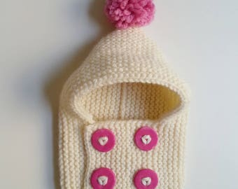 Hat(Cap) cowl for born babies in 2 years hand-knitted woolen ecru with pink buttons and pompom