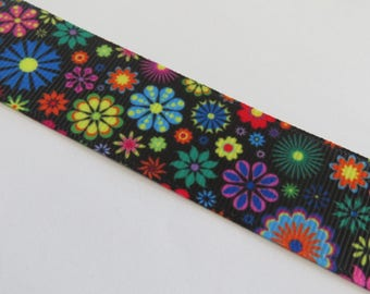 Pretty black ribbon with multicolor flower pattern