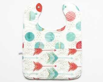 Large baby or toddler bib. White cotton with arrows and dots. Mint, coral, gold. White cotton terry back.