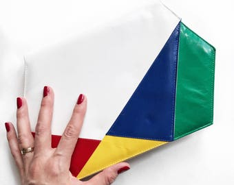 Asymmetrical envelope leather clutch/purse in primary colours.